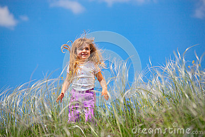 Little girl walks on the field