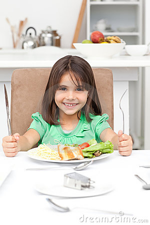 Adorable llittle girl holding forks to eat
