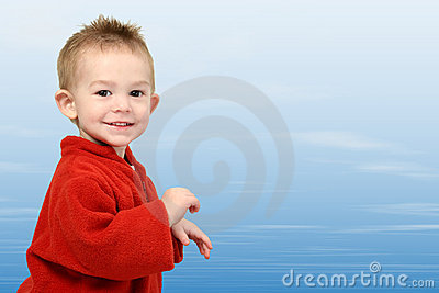 Adorable One Year Old in Red Sweater on Blue Sky