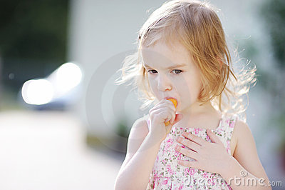 Adorable Preschooler Girl Eating Carrot Stock Images - Image: 20409944
