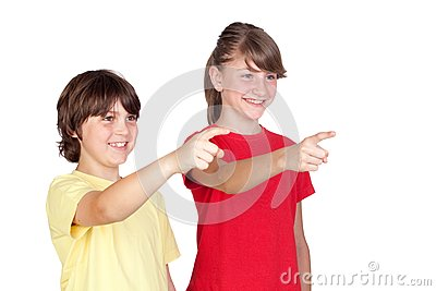 Adorable preteen girl and little boy finger pointi
