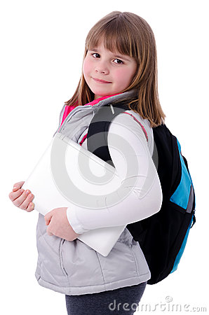 Adorable school girl with laptop