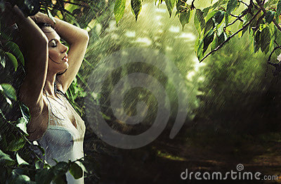 Adorable sexy brunette in a rain forest