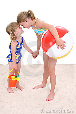 Adorable Sisters Playing In The Sand