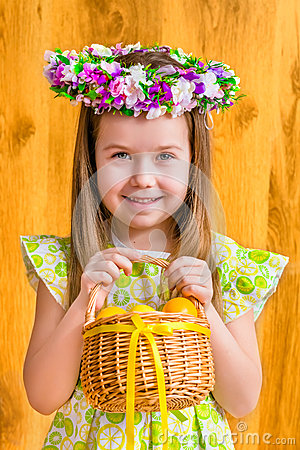Free Adorable Smiling Little Girl With Long Blond Hair Wearing Floral Head Wreath And Holding Wicker Basket With Yellow Eggs Royalty Free Stock Photo - 51857945