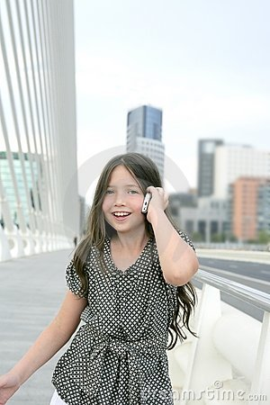 Adorable teenager little girl talking phone