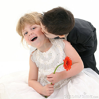 Adorable Toddler Boy Giving Pretty Four Year Old Girl A Kiss