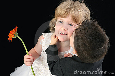 Adorable Toddler Boy Kissing Four Year Old Girl On Cheek