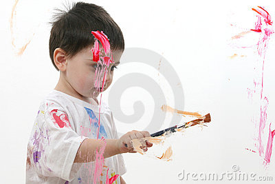 Adorable Toddler Boy Painting On Glass