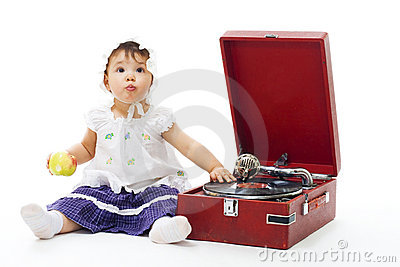 Adorable Toddler girl with gramophone