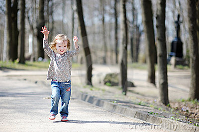 Adorable Toddler Girl Jumping Outdoors Stock Photos - Image: 19380883