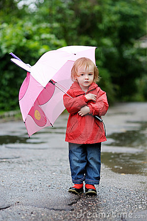 Adorable toddler girl at rainy day