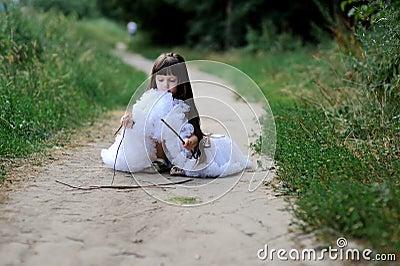 Adorable toddler girl in white tutu skirt