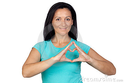 Adorable woman making a heart with the hand
