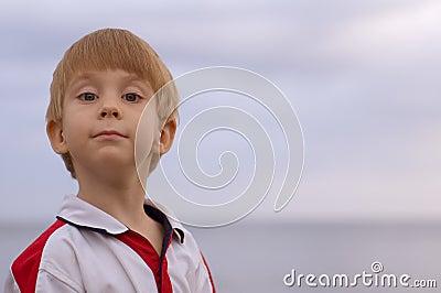 Adorable young boy looking at camera