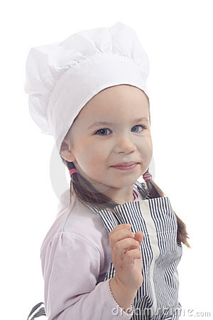Adorable young girl in the cook costume