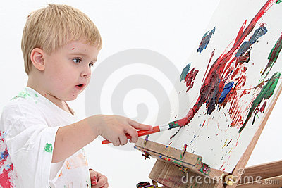 AdorableToddler Boy Painting At Easel