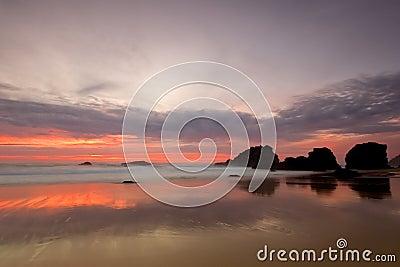 Adraga beach red sunset
