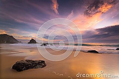 Adraga beach at sunset