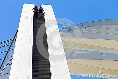 Adrenaline Junkies Climbing Steps Editorial Stock Image