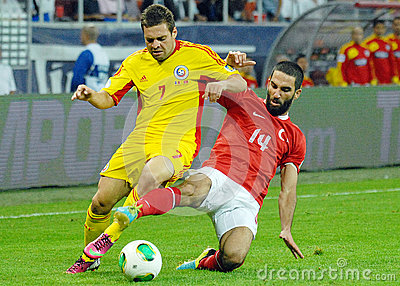 Adrian Popa and Arda Turan in Romania-Turkey World Cup Qualifier Game Editorial Stock Photo