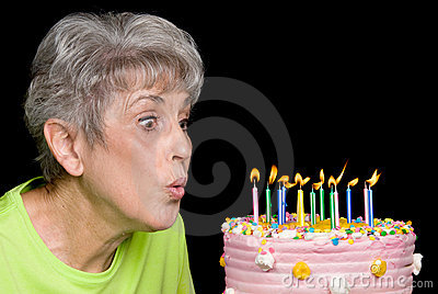 Adult blowing out candles