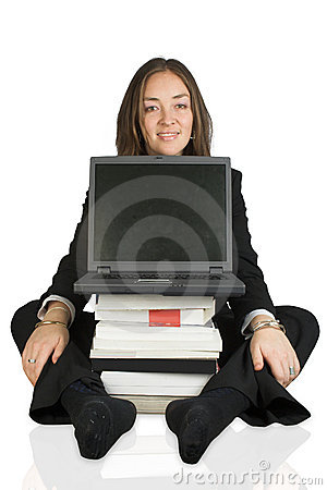 Adult business learning - laptop on books