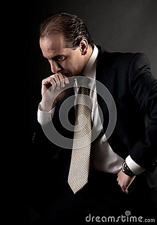 Adult businessman serious thinking sitting