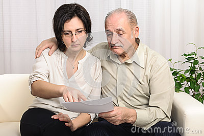Adult daughter helping sad elderly man