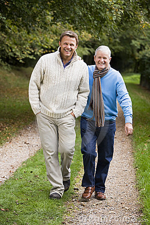 Free Adult Father And Son Walking Along Path Royalty Free Stock Image - 5309736