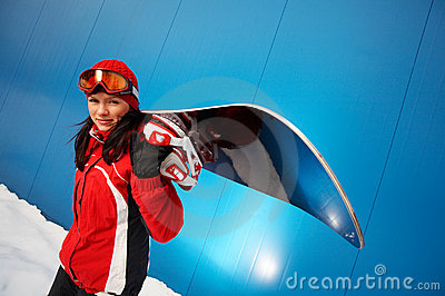 Adult female (age 20-25) snowboarder.