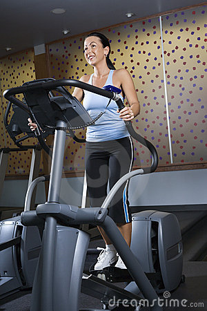 Adult female on elliptical machine.