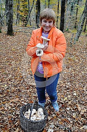 Adult female gathering wild mushrooms