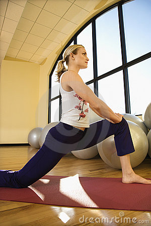 Free Adult Female Stretching At Gym Royalty Free Stock Photos - 2044708