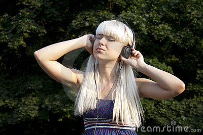 Adult girl listening to the music