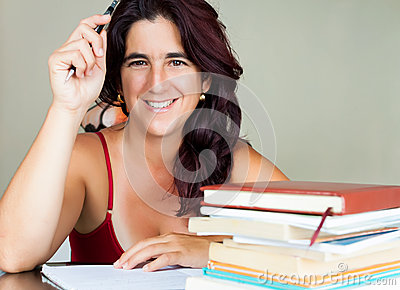Adult hispanic woman studying