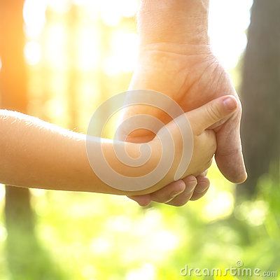 Free Adult Holding A Child S Hand, Close-up Hands Stock Photography - 48492432