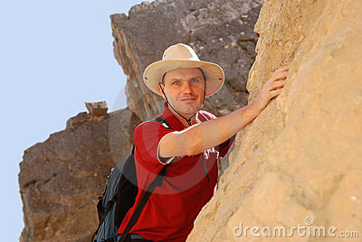 Adult man climbing on rock