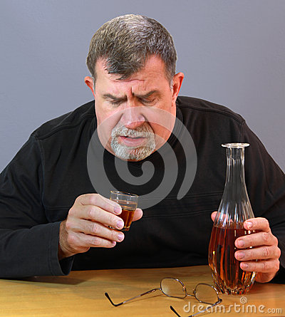 Adult Man Contemplates His Next Drink