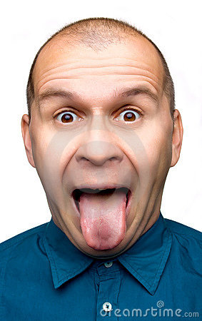 Adult man sticking tongue out