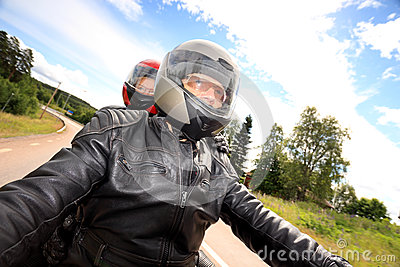 Adult man and woman bikers on the road