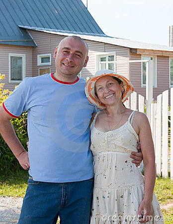 Adult Man And Woman Near Gate Of  Home Stock Image - Image: 24223981