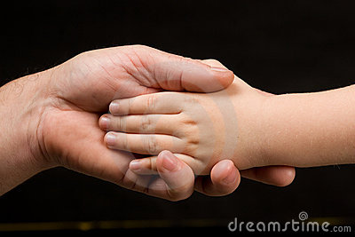 Adult palm holding child s hand