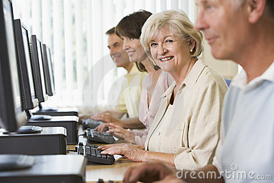 Adult students on a computer