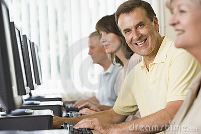 Adult students on computers