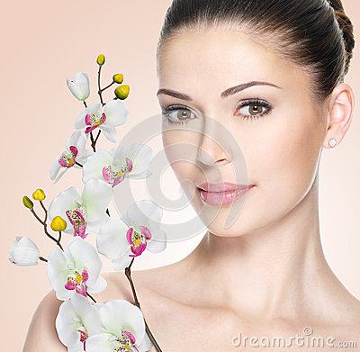 Adult woman with beautiful face and flowers