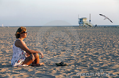 Adult woman on a coast of ocean