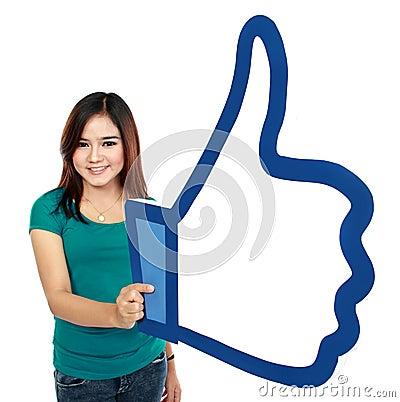 Adult woman holding like symbol Editorial Photo