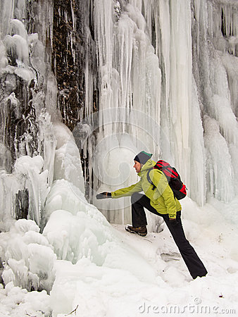 Adult woman looks at an icicle