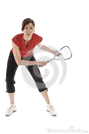 Adult woman playing squash